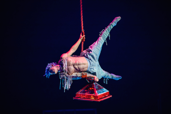 Waz performs aerial feats with the red Acro Lamp.