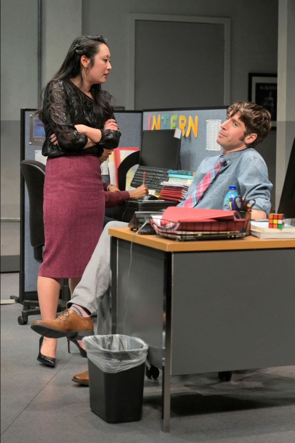 Editorial assistants Kendra (Melanie Arii Mah) and Dean (Jeremy Kahn) trade insults in the magazine office. Photo: Kevin Berne.