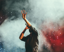 Singer onstage. Photo by Austin Neill via Unsplash.