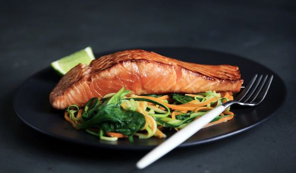 Salmon and vegetables. Photo by Caroline Attwood via Unsplash.