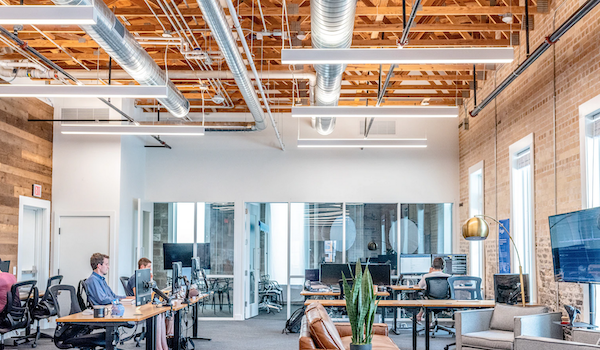 Open office. Photo by Austin Distel via Unsplash.