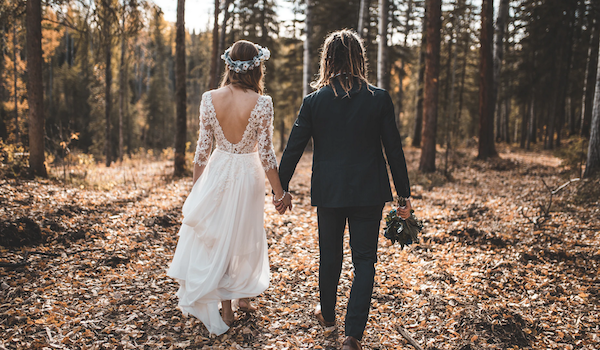 Wedding in the woods. Photo by bantersnaps via Unsplash.