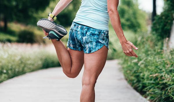 Woman stretching leg. Photo by Matthew LeJune via Unsplash.