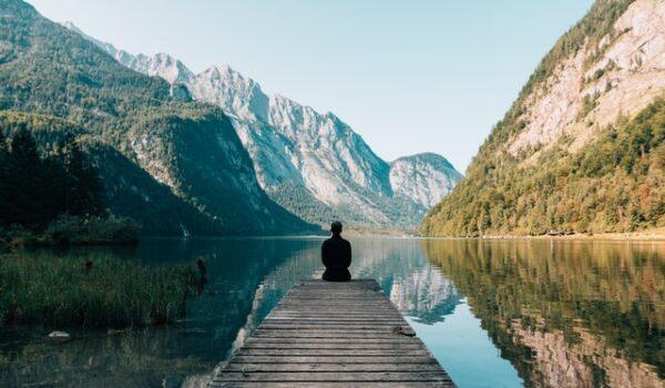 Man Sitting On Grey Dock