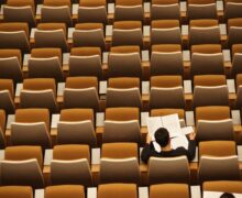 Student in an empty classroom