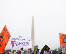 "March on Washington, sign reads ""electoral college flunked"""