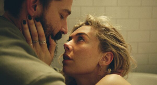 A screenshot from the film Pieces of a Woman of two characters in a bathtub, the actress Vanessa Kirby with her hand caressing the face of actor Shia LaBeouf